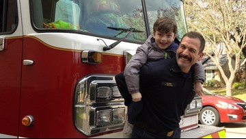 Dallas firefighter carries 6-year-old son up 70 flights of stairs for cancer research