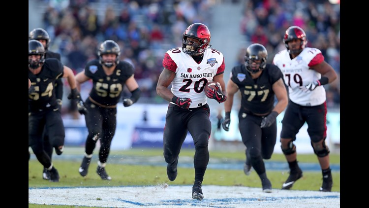 Rashaad Penny #20 of the San Diego State Aztecs scores a touchdown against the Army Black Knights in the Lockheed Martin Armed Forces Bowl at Amon G. Carter Stadium on December 23, 2017 in Fort Worth, Texas.