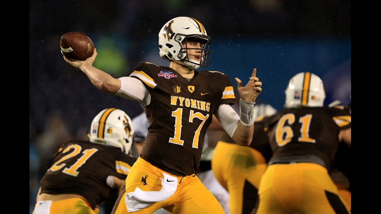 Josh Allen #17 of the Wyoming Cowboys passes the ball during the first half of the Poinsettia Bowl at Qualcomm Stadium on December 21, 2016 in San Diego, California. (Photo by Sean M. Haffey/Getty Images)