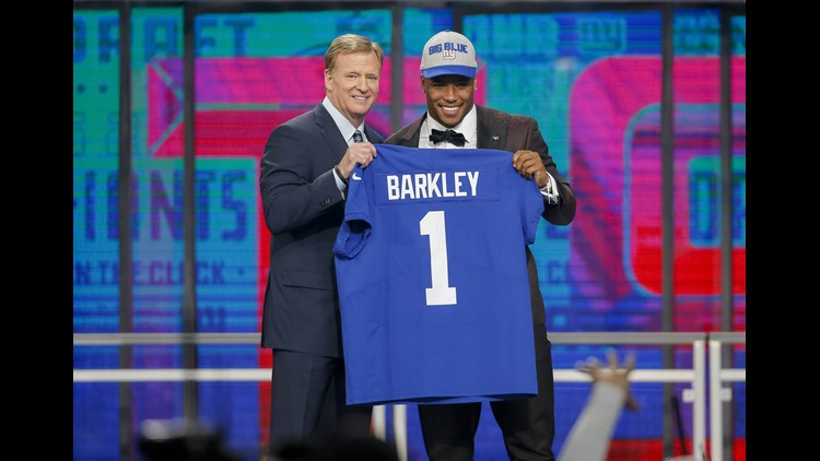 Saquon Barkley (Penn State) poses with NFL commissioner Roger Goodell after being selected as the number two overall pick to the New York Giants in the first round of the 2018 NFL Draft at AT&T Stadium. Mandatory Credit: Tim Heitman-USA TODAY Sports