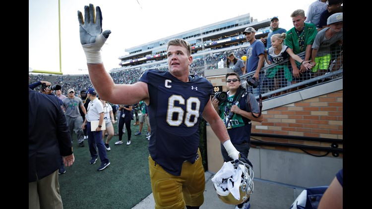 Mike McGlinchey #68 of the Notre Dame Fighting Irish celebrates as he leaves the field following a game against the Temple Owls at Notre Dame Stadium in South Bend, Indiana. The Irish won 49-16. (Photo by Joe Robbins/Getty Images)