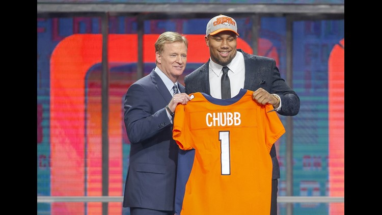 Bradley Chubb (North Carolina State) poses with NFL commissioner Roger Goodell after being selected as the number five overall pick to the Denver Broncos in the first round of the 2018 NFL Draft at AT&T Stadium.