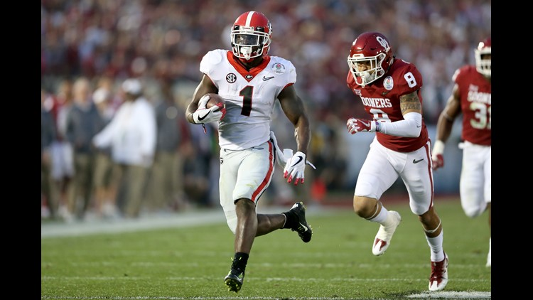 Running back Sony Michel #1 of the Georgia Bulldogs scores on a 38-yard touchdown in the third quarter against the the Oklahoma Sooners in the 2018 College Football Playoff Semifinal at the Rose Bowl Game in Pasadena, California.