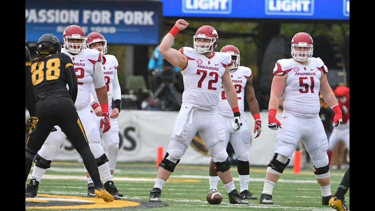 Arkansas Razorbacks offensive lineman Frank Ragnow (72) signals at the line of scrimmage to the rest of the offensive line during the first half agains the Missouri Tigers at Faurot Field. Missouri won 28-24.