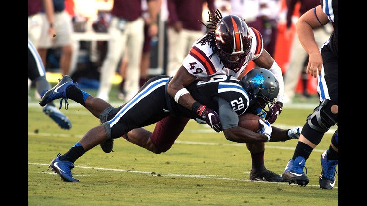 Shaun Wilson #29 of the Duke Blue Devils leaps for extra yardage against Tremaine Edmunds #49 of the Virginia Tech Hokies at Wallace Wade Stadium on November 5, 2016 in Durham, North Carolina.