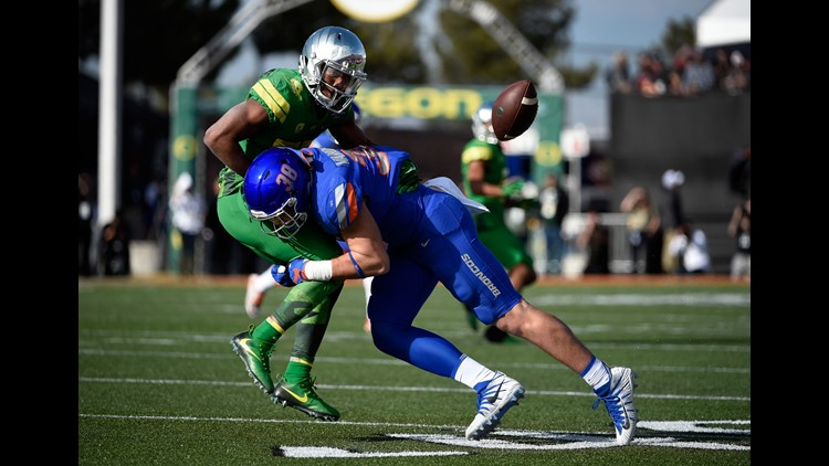 Tony Brooks-James #20 of the Oregon Ducks fumbles the ball under pressure from Leighton Vander Esch #38 of the Boise State Broncos during the first half of the Las Vegas Bowl at Sam Boyd Stadium on December 16, 2017 in Las Vegas, Nevada.