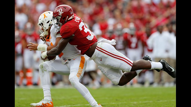 Rashaan Evans #32 of the Alabama Crimson Tide tackles Jarrett Guarantano #2 of the Tennessee Volunteers at Bryant-Denny Stadium on October 21, 2017 in Tuscaloosa, Alabama.